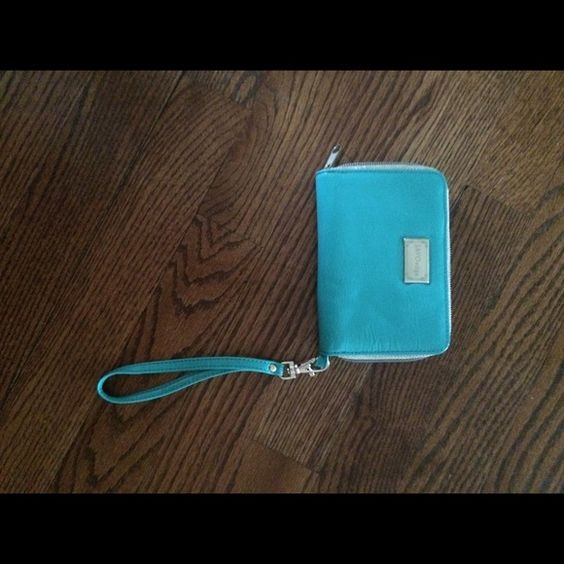 Wristlet Turquoise and gold accent. Never used. Space for a phone and money. Very useful as a small purse or wallet. Bags Clutches & Wristlets