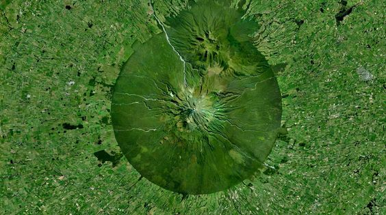 The sharp contrast between the national park around the Mt. Taranaki volcano in New Zealand and the farmland encircling it