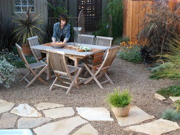 Pair stone or gravel with bigger pavers for a patio design that guests will pay tribute to