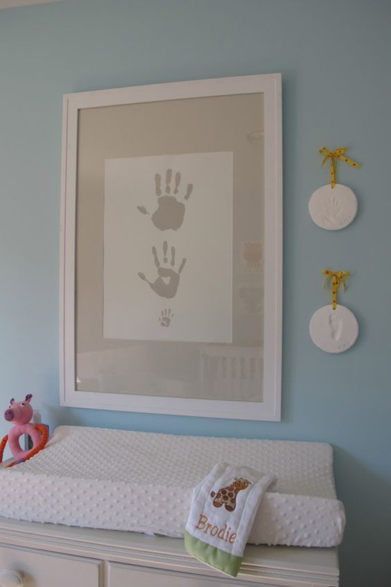 The decorating doesn't have to end once baby arrives! DIY a sweet nursery wall print: handprints for daddy, mommy and baby!