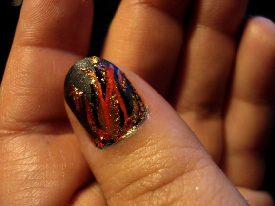 hunger games nails on fire   https://artsyarchitette.wordpress.com/2012/03/13/nails-on-fire-the-hunger-games-china-glaze-capitol-colours-collection/