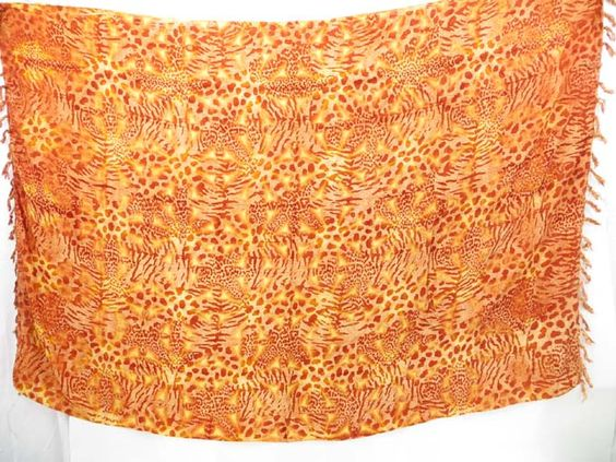 sarong beach wraps orange brown animal skin print $4.95 - http://www.wholesalesarong.com/blog/sarong-beach-wraps-orange-brown-animal-skin-print-4-95/