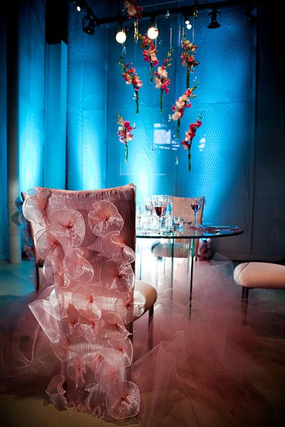 Insane chair covers AND a hanging centerpiece