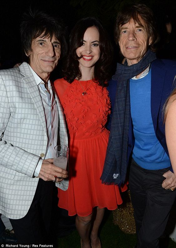 Off-duty rockers: Sir Mick chats to bandmate Ronnie Wood and his wife Sally