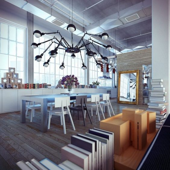 Cool, industrial-looking idea for a chandelier. I can't imaging needing to use all of that electricity, though.