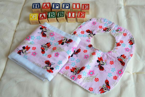 Pink Minnie Mouse Bib & Burpcloth Set. $15.00, via Etsy.  Love this! One of my good friends from a while back just started up this company!