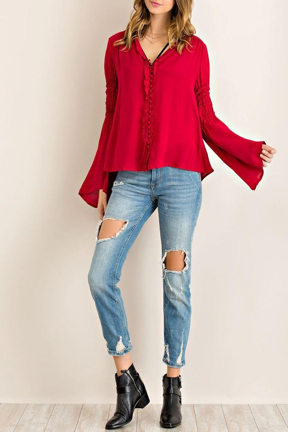 Solid rayon button down ruffle detail blouse featuring elasticized sleeve with edge ruffle. Bell-sleeves. Non-sheer. Woven. Lightweight.   Ruffle Detail Blouse by Entro. Clothing - Tops - Blouses & Shirts Clothing - Tops - Long Sleeve California