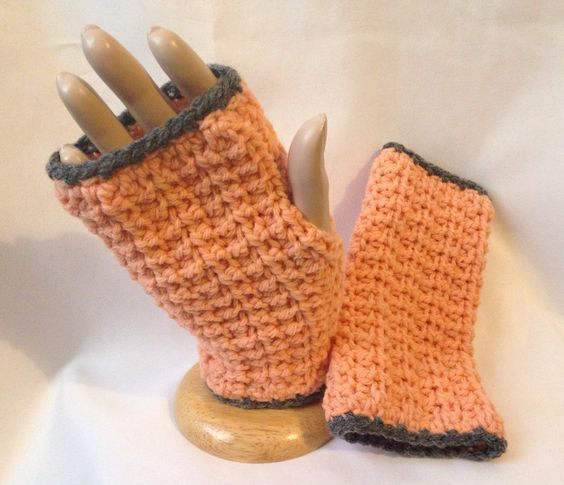 These cozy, textured Honeycomb Fingerless Mittens were crocheted using 100% acrylic in peach with grey trim. MEASUREMENTS 4 inches in width 7 inches in length   CARE Gentle handwash and lay flat to dry for best results and longer life.