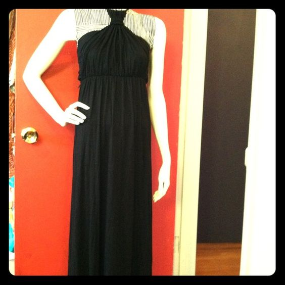 Halter maxi dress This adorable ankle length maxi has a double layer top from the waist up-elastic tub-top with the second layer cris-crossing over to tie around the neck as a halter. Great if you're a little bustier & need support w/o a bra ;) black & cotton jersey blend Dresses Maxi