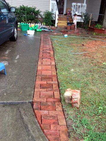 Driveways bricks and driveway edging on pinterest for Brick sidewalk edging