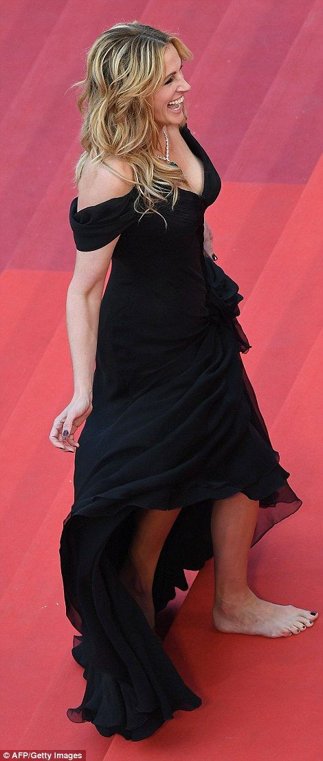 Barefoot beauty: Julia Roberts oozed sophistication in a classic black dress as she arrive...: