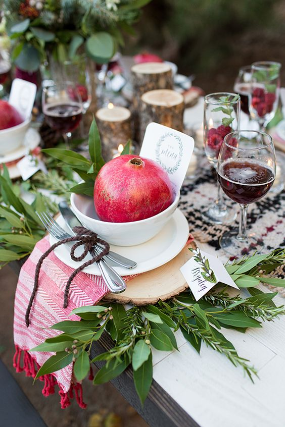 pomegranate place setting, photo by Tyler Rye Photography http://ruffledblog.com/a-desert-christmas-wedding #weddingideas #placesetting: