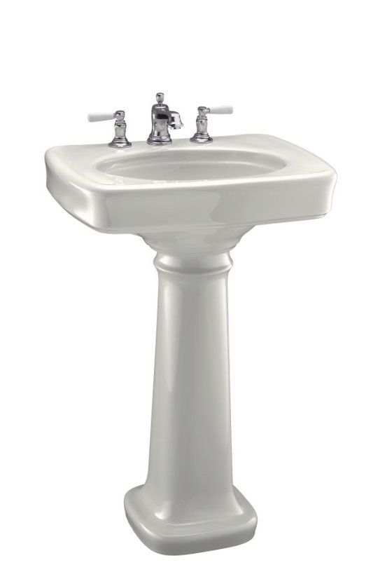 A pedestal/vanity like this one would be period-appropriate. Kohler. Good quality. Not super-expensive.