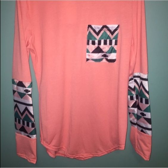 CHIFFON Watermelon Aztec Tribal Top w/Pocket  NWOT Cute watermelon color long-sleeve top. Arms and pocket done in beautiful green, peach and black CHIFFON print. Color of top looks like the first photo. Measures 17 inches pit to pit and 22 inches back collar to bottom hem. Boutique Tops Tees - Long Sleeve