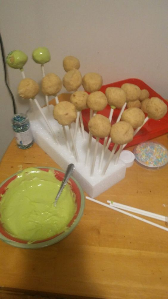 Cake pops made easy   *make a boxed cake  *crumble the cake into bowl  *add half container of frosting   *mix it till it seems doughy   *roll balls by hand  *melt candy melts, stir every 20 seconds  *dip pop sticks into melts then push sticks halfway into ball (let dry) *carefully coat pops into the melt   (I turn the bowl) be sure to tap it a little for excess melt to drip off *press pop sticks into styrofoam (add sprinkles) let dry  *store in fridge over night and enjoy
