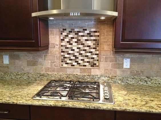 3x6 tumbled travertine backsplash w/ glass tile inlay behind stove in Tampa, Florida  ceramictec.com