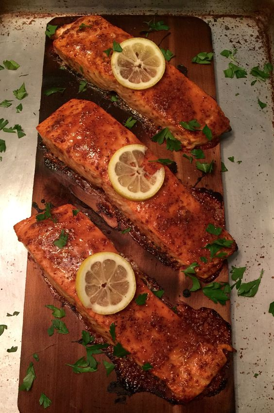 Maple Mustard Cedar-Planked Salmon, on the grill, perfect for summer. Simple and delicious with the smoky cedar, it will wow your family or guests.