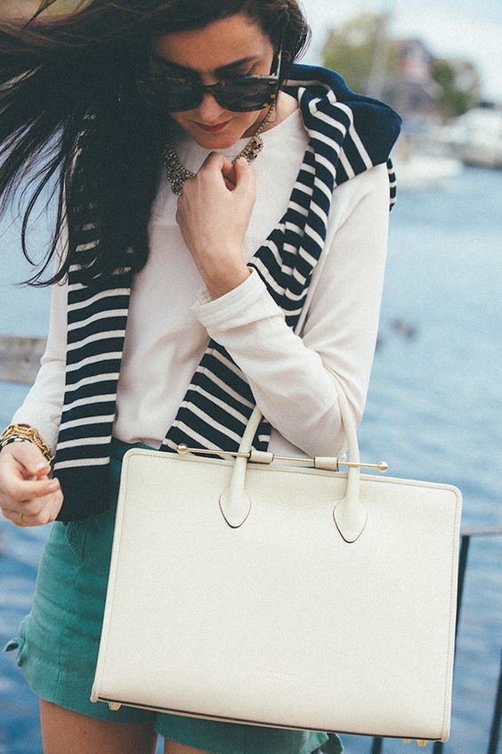White shirt, green shorts, white tote, navy & white sweater & sparkly necklace. Classy Girls Wear Pearls