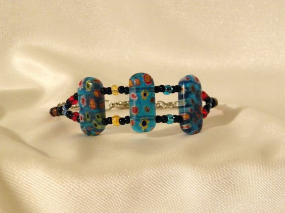 Double strands connect oblong floral pattern glass beads in these funky, playful bracelets. $8