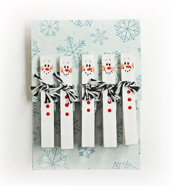 D.I.Y. Snowman Clothespins #Christmas This would be so cute with a magnet on the back to hold Christmas cards on the fridge: