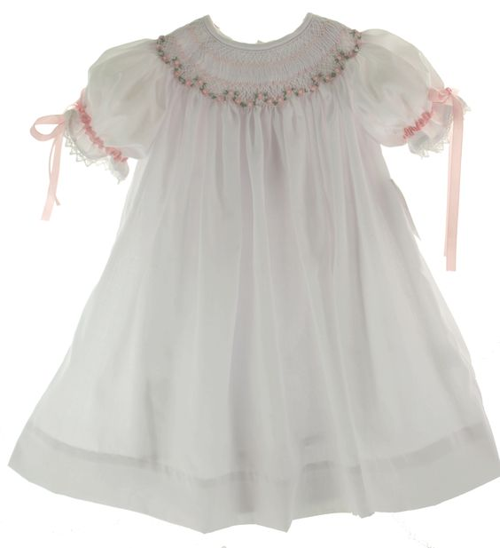 This crisp white girls dress is a true Feltman Brothers classic! The top of this beauty features smocking covered in lovely diamond embroidery until the waist, and scallop edges along the collar and cuffs.5/5(3).