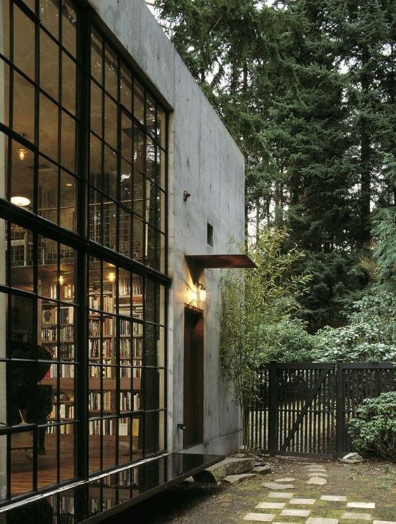 the library. the windows. the bench. Protruding wing protecting door window from the weather. Mini porch!