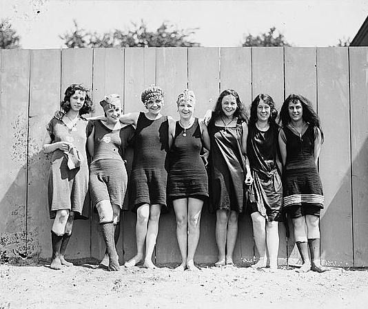 love this picture. 1920's. Friends hanging out together swimming.