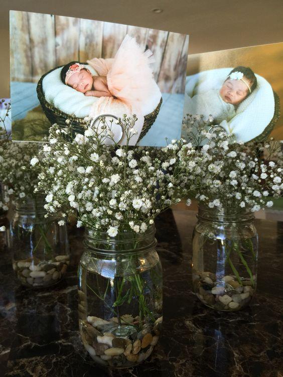 Centerpieces for baby girl's baptism reception: mason jar, rocks, photoholder, baby's breath