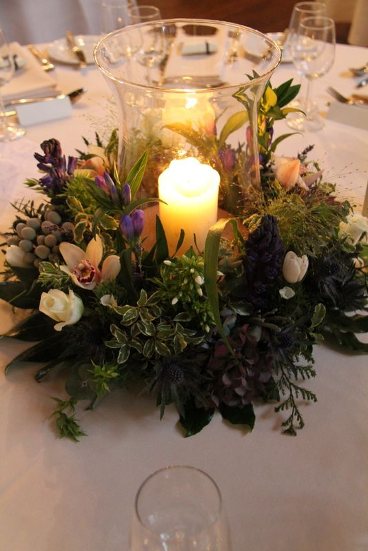 A traditionally beautiful hurricane vase and floral wreath arrangement. Hire your hurricane vases from us! #weddinghirebristol