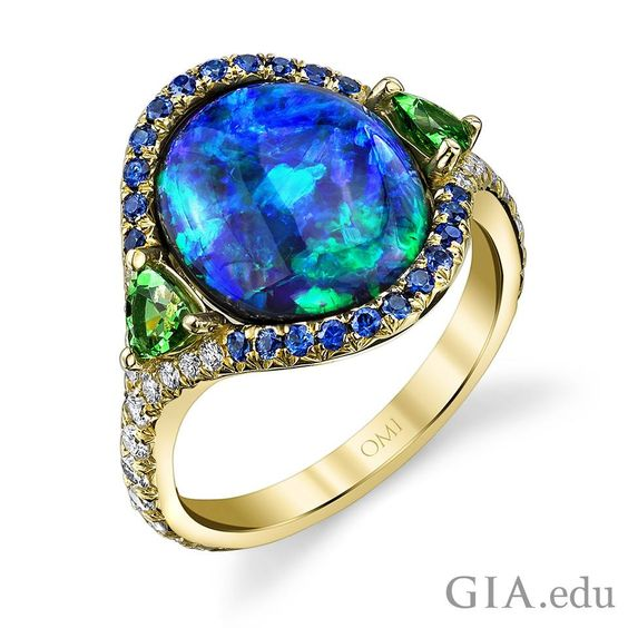#Opal has been revered for centuries as a gemstone that possesses a unique optical characteristic, as in this stunning opal ring. Do you know what this characteristic is called? Courtesy: Omi Privé