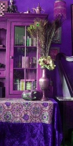 Not necessarily my choice of color but I think this is very well done - purple, peacock, tone on tone...very dramatic.