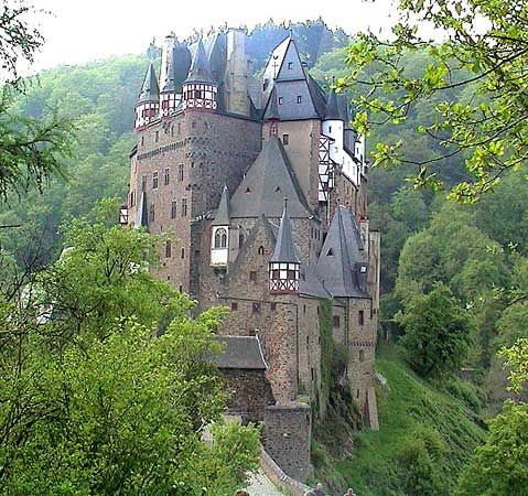Burg Eltz    Castle Eltz is one of the most beautiful and best preserved castles in Germany. It lies in a romantic setting surrounded by an unspoiled landscape, inviting and majestic at the same time - like a fairy-tale castle come to life. You will find history cast in stone and you will feel yourself immersed in the spirit of a past revived -