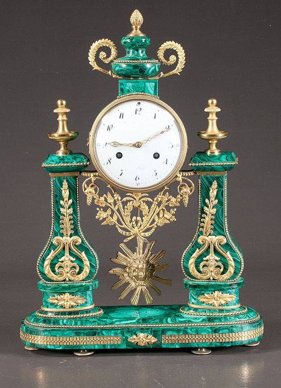 "Louis XVI malachite mantle clock with bronze ormolu mounts with enamelled dial, marked ""Paris"", c.1890, 14"" wide, 18"" high"