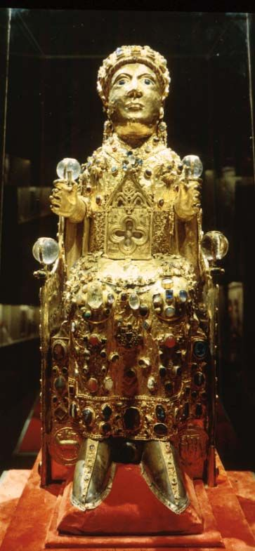 "Reliquary Statue of Sainte Foy (St. Faith). Abbey Church at Conques, Conques, France. Late 9th century or 10th century with later additions. Silver gilt over a wood core, with added gems and cameos of various dates. Height 33"". Church Treasury, Conques."