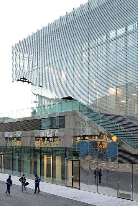 Jules Ladoumègue Sports Centre features a facade of moving glass shutters.