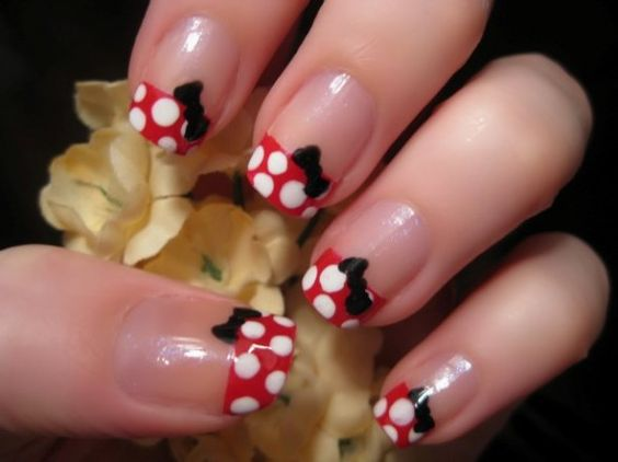 Minnie Mouse nails.