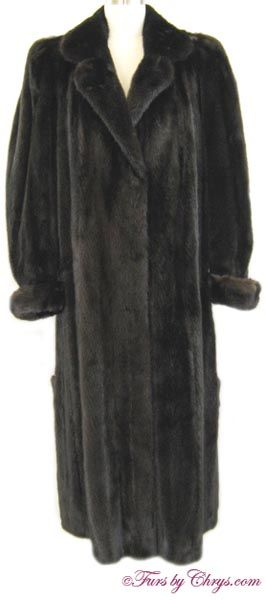 """Long Ranch Mink Coat RM798; $2100; Excellent Condition; Size range: 8 - 12 (possibly 14). This is a stunning genuine natural ranch mink fur coat in a nice, long length. It has Designer Furs Ltd. label and features a notched collar, and turn-back cuffs. There are many special features on this mink coat: pleated shoulders, unique and stylish 23"""" side slits with buttoned tabs, and a notch in each turn-back cuff. It is truly a very original fur coat! It appraised for $16,000. Wear it and love…"""