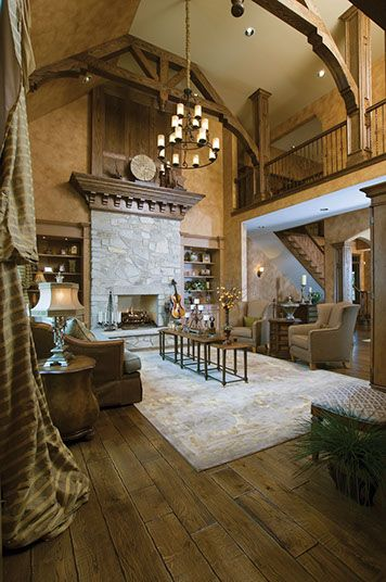 Rustic Great Room Distressed Floors Volume Ceiling And