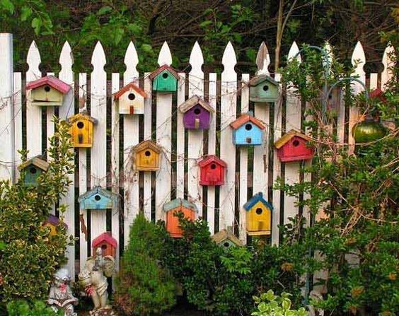 34 Easy and Cheap DIY Art Projects To Dress Up Your Garden - Adorn Your Fence with Birdhouses