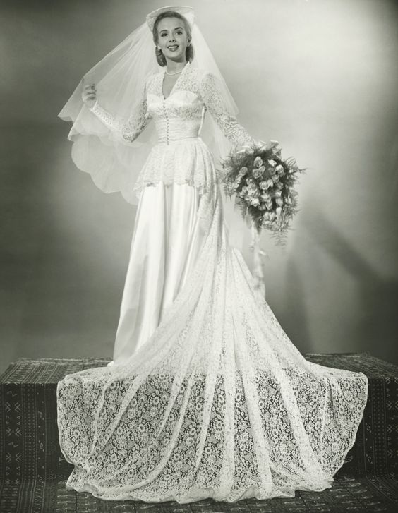 [I like the scalloped veil, but isn't that headpiece awful?] How wedding dresses used to look...