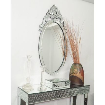Interio Beautiful Crown Wall Mirror - Make visitors to your home envious of your home decor skills with this ornately crafted premium grade Venetian mirror. Its silver colored frame is beautiful to look at for the handiwork in it and the glass has been bezelled along the perimeter. It not only looks beautiful but is also highly utilitarian.