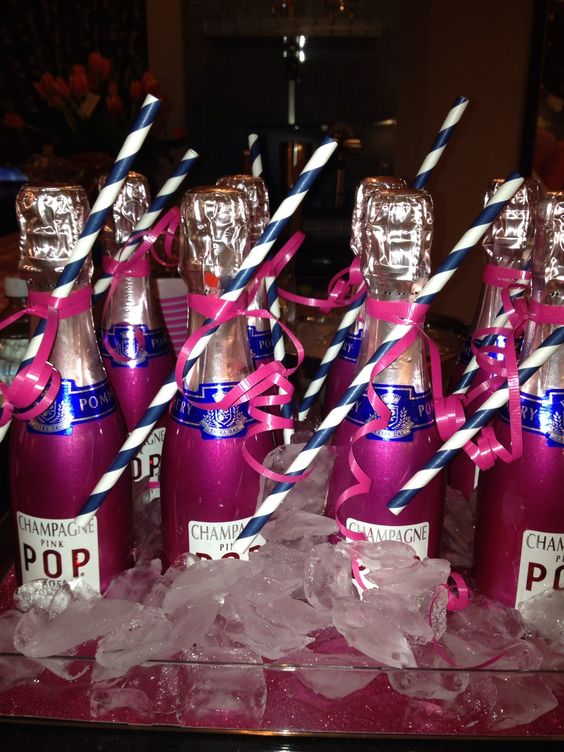 Individual Champagne bottles in PINK  NAVY change to purple and silver for the bridal shower :)!