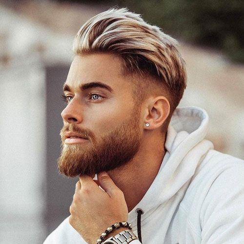 Best Hairstyle For Oval Face Men Mid Fade Haircut With Thick Brushed Back Hair On Top And Full Beard Oval Face Men Mid Fade Haircut Oval Face Hairstyles