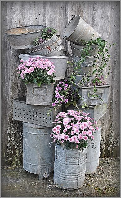 Galvanized containers for the Garden. I love the one in front with the curly legs!: