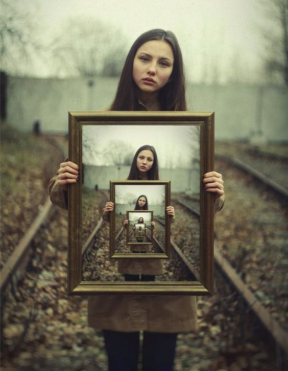 I like this image because an illusion is created through digital manipulation. This image could possibly have a sad narrative behind it due to the models facial expression and the bleak color of the image.