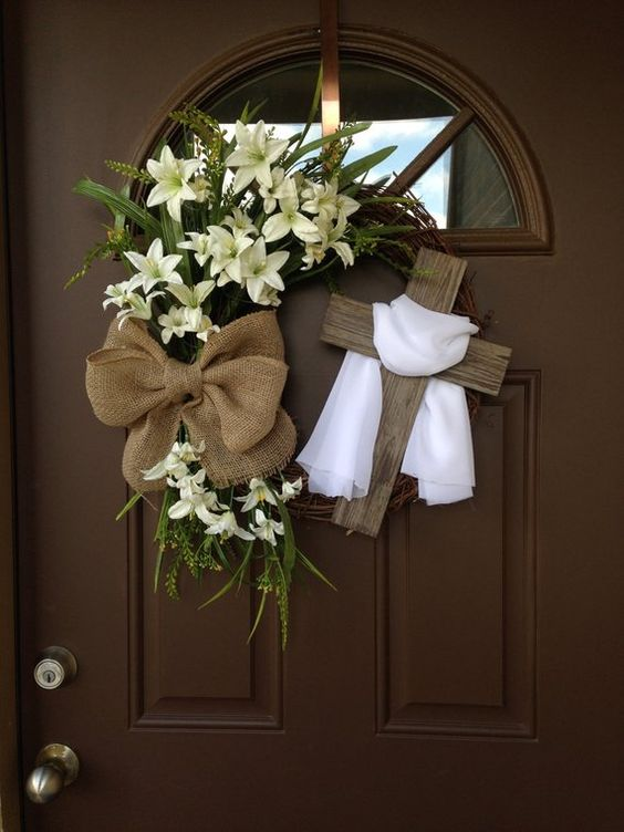 Beautiful Easter grapevine wreath with cream lilies,greenery and rustic burlap bow,accented with rustic cross and white veil over it. If you choose both white and purple veil ,only the purple veil will be on the cross,I will send you additional white veil that you can place on the cross on Easter