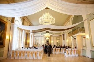 White voile & gold organza ceiling drapes. I read somewhere that voile is one of the less expensive fabrics, and it looks great here!