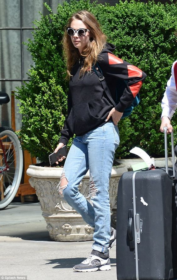 Quirky:Cara Delevingne wore a pair of leftfield black and white sunglasses when she stepp...