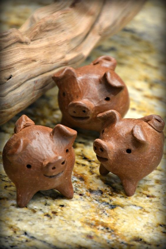"These sweet little Good Luck Chanchitos are handcrafted by Fair Trade artisans in the village of Pomaire, Chile and when walking through this small town, these little pigs can be found hanging in homes, shops and restaurants, bringing a sense of comfort to all who sees them.  Our ""Chanchitos"" or ""Little Pigs"" are believed to be very lucky, particularly if they only have three legs.  Good Luck Chanchitos are traditionally given as a gift to family and friends as a symbol of goodwill or luck."
