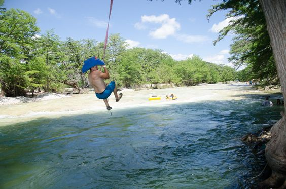 Rope Swing located in front of the Beach Club Cabins at Frio Country Resort!